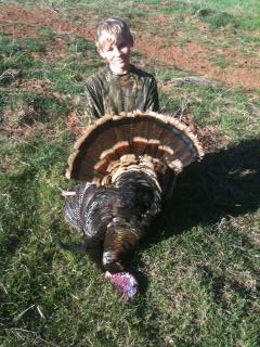 DIY KS or OK Turkey Hunts-colter-smiley-1st-bird.jpg